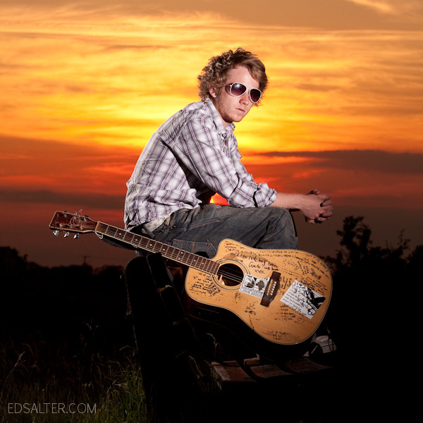 Ant with guitar at sunset