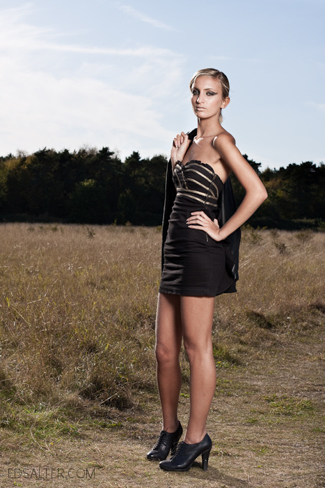 black dress with gold in country side