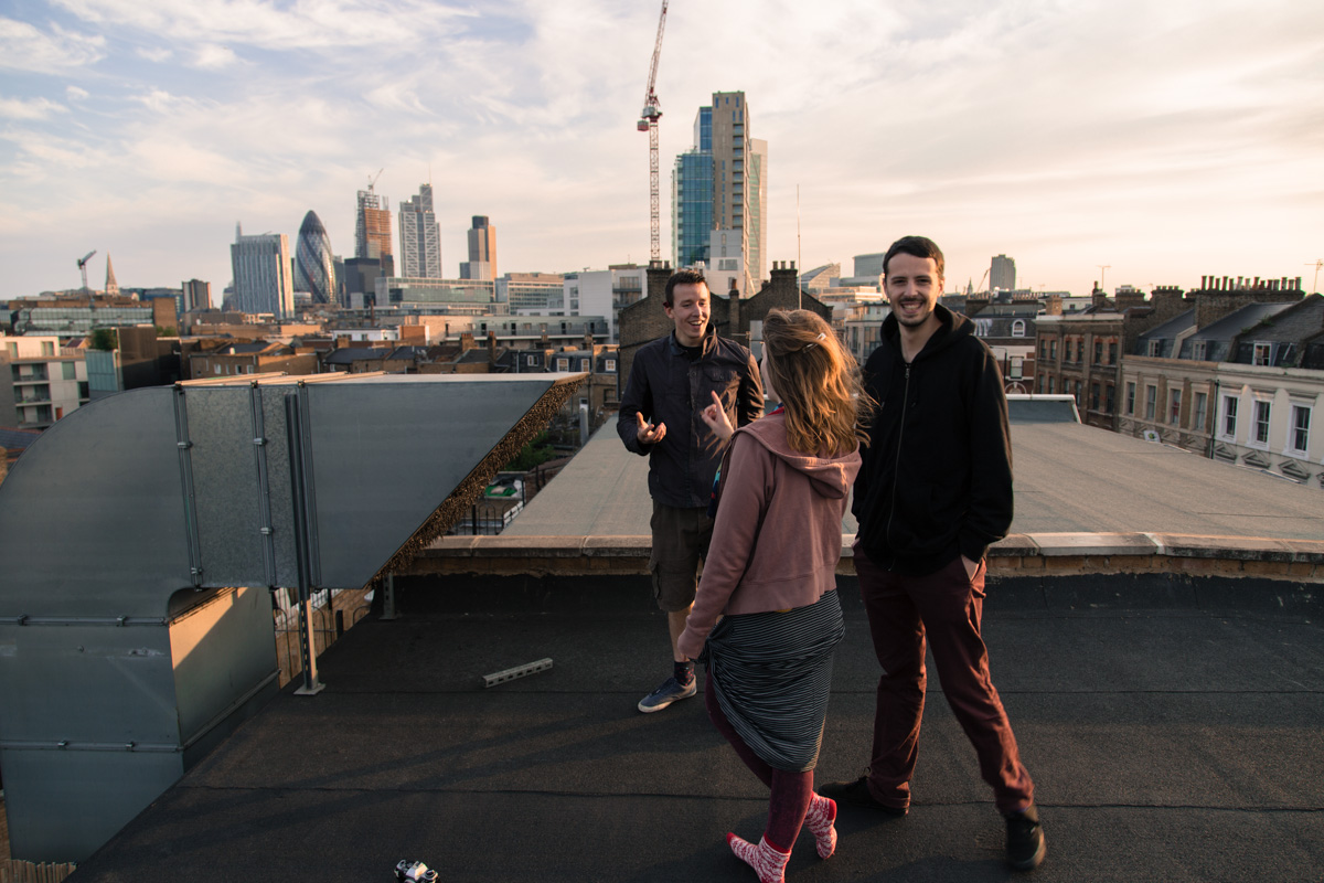 People on an East London rooftop over looking the city buildings