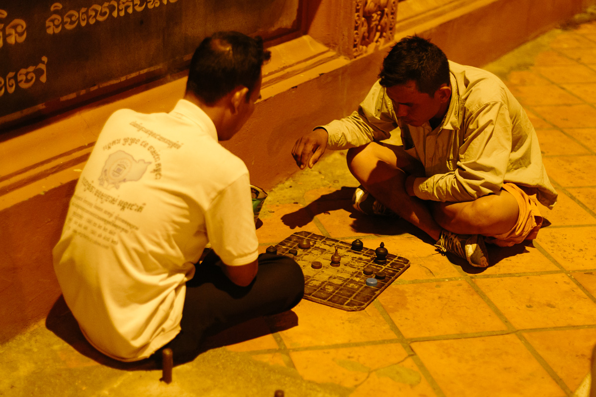 Locals playing chess on the streets of Phon Phen