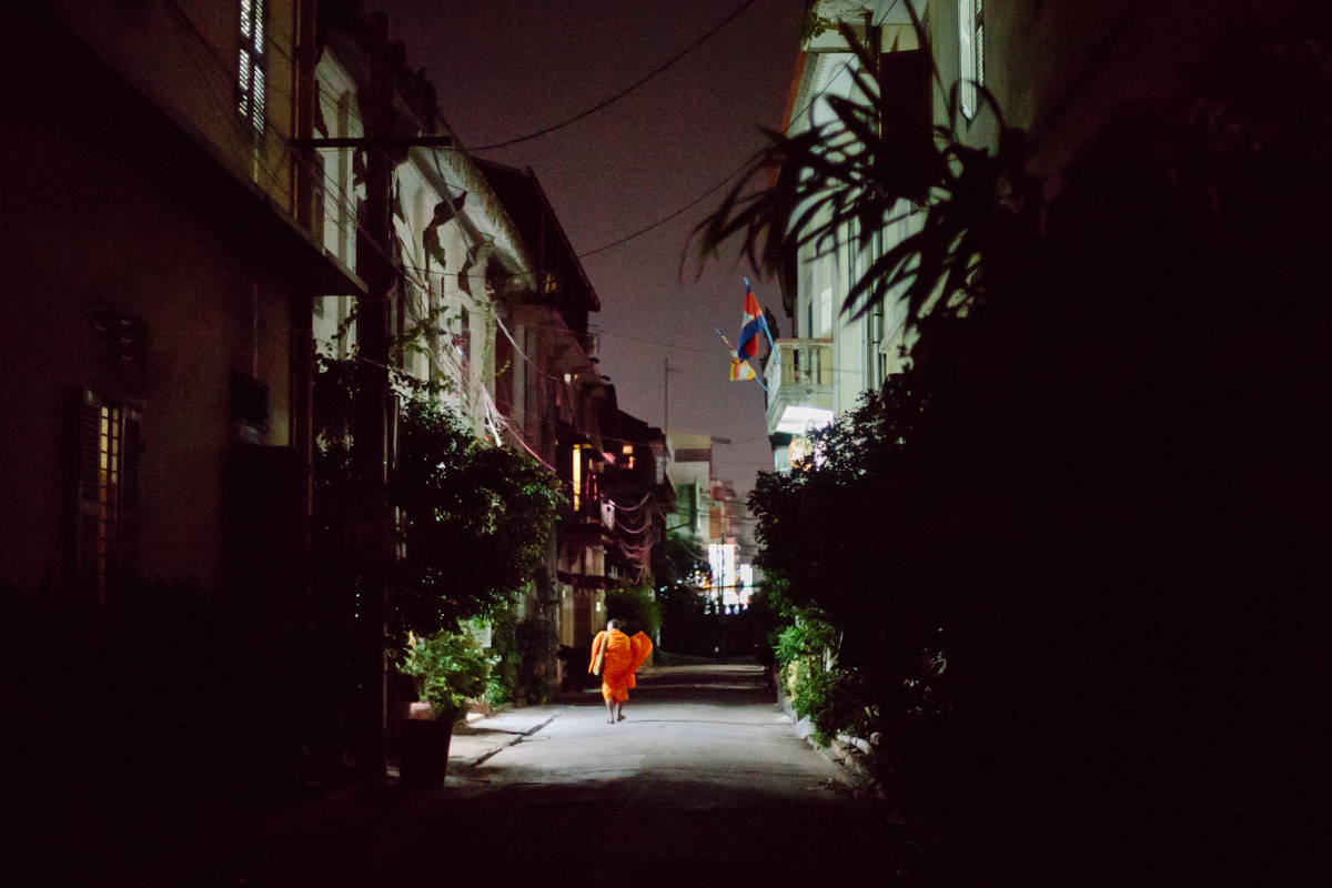 Monk walking in the street at a monastery in night in Phnom Penh