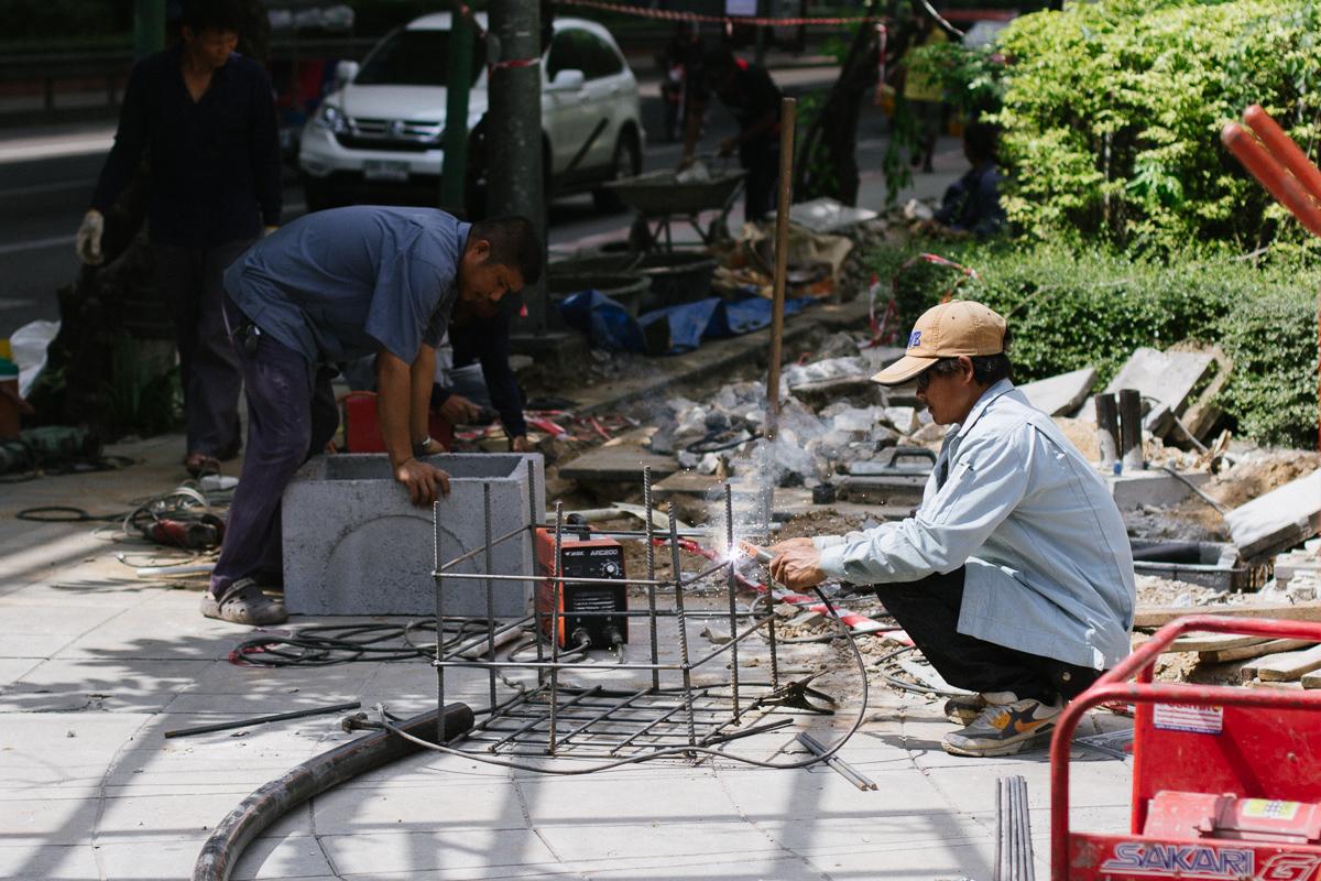 Street worker welding