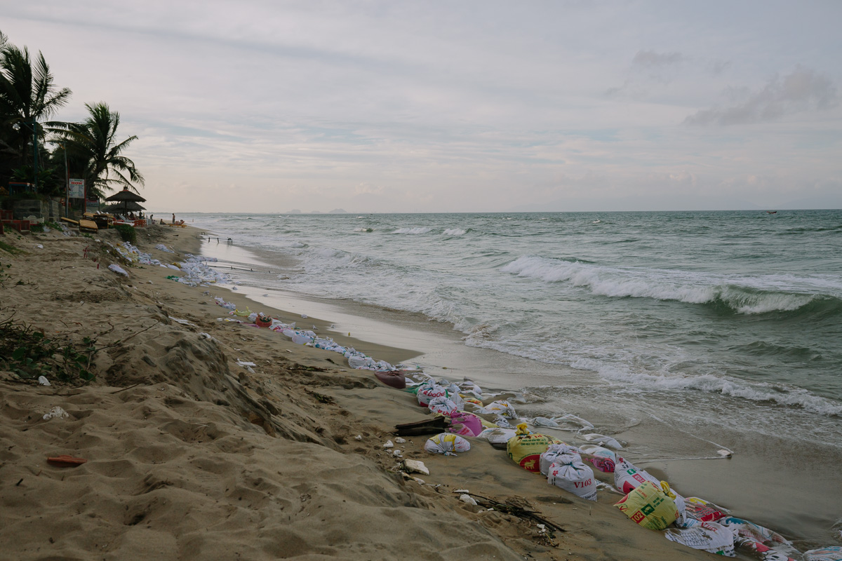 Bags of sand strewn across the beach