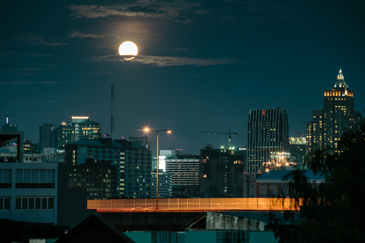 View over Bangkok by night with the rising moon