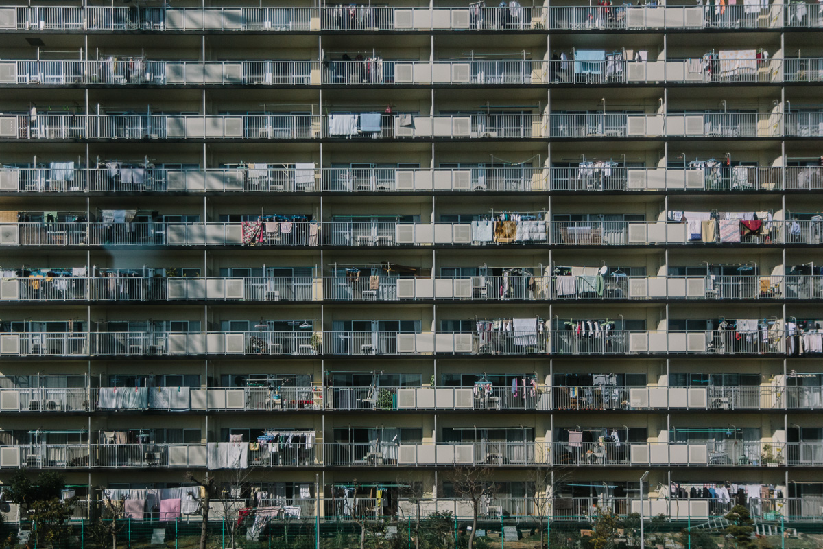 An apartment block on the outskirts of Tokyo fom the airport train