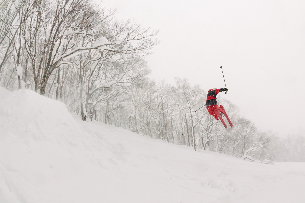 Brad kicks it out on a booter off piste in Niseko